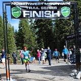 Photo Credit: CONTRIBUTED PHOTO: BETH WOLFSONG - Jennifer Wolfsong crosses the finish line on Sunday morning in the Mountain Lakes 100 run at Lake Olallie in the Mount Hood National Forest. She ran to draw attention to an annual dolphin slaughter in Taiji, Japan.