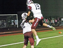 Photo Credit: DAN BROOD - CELEBRATION TIME -- Sherwood senior Evan Thomson (19) celebrates with senior Austin Tietsort following a Bowmen touchdown in the team's 38-28 win at Tualatin on Friday.