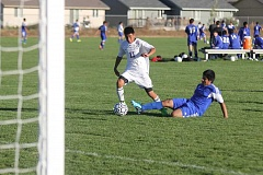 Photo Credit: JEFF WILSON/THE PIONEER - Jonathan Reynoso works around a Crook County defender during Monday's Tri-Valley Conference match. Madras won 3-1.