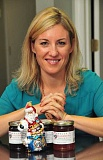 Photo Credit: STAFF PHOTO: VERN UYETAKE - Lake Oswego entrepreneur Kelly Calibria, founder of the zippy Kellys Jelly line of sweet and savory jellies, has launched a line of collector holiday ornaments. She worked with Richard Bloom of R. Blooms Florist in Lake Oswego to design a 2014 Kellys Jelly Radko ornament. I had an idea and Richard had ideas, she said. We went through the catalog and then collaborated on a design. This years ornament features Santa and Im already thinking about next years design. A limited amount of ornaments will be made each year and will be sold in gift packs with an assortment of jellies. The special ornaments will be available at R. Blooms, 267 A Avenue in Lake Oswego, and online at kellysjelly.com. For pricing and availability, check the website.