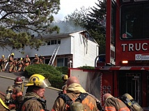Photo Credit: PHOTO COURTESY: CLACKAMAS FIRE - Firefighters arrived to the four-unit structure in Milwaukie to see heavy smoke coming from the front doors of two units.