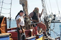 Photo Credit: COURTESY OF SET SAIL FOR A CAUSE - Supporters - and pirates - of the Tall Ship Royaliste celebrate its sailing after repairs (above, left), which happened to be on International Talk Like A Pirate Day.