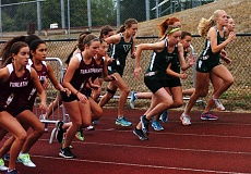 Photo Credit: DAN BROOD - AT THE START -- Girls cross country runners from Tigard and Tualatin take off at the start of a regular season meet. The Tigers, Timberwolves and Sherwood Bowmen will be competing at Wednesday's Three Rivers League district meet.