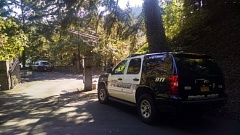 Photo Credit: KOIN 6 NEWS - Lake Oswego Police cars are parked at the end of Twin Points Rd. for a death investigation.