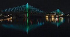 Photo Credit: TRIBUNE PHOTO: JONATHAN HOUSE - Tilikum Crossing, Bridge of the People, lit with new lights.
