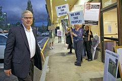Photo Credit: PAMPLIN MEDIA GROUP: TROY WAYRYNEN - Damascus Mayor Steve Spinnett, left, is unfazed as he walks by protesters shouting Free our city! Free our city! on his way to a City Council meeting Monday, Oct. 20.