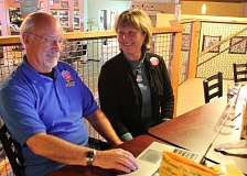 Photo Credit: HOLLY M. GILL - Jefferson County Commission candidate Tom Brown and his wife, Janet, check out election results online while seated with friends at Crossroads Pub and Grill.