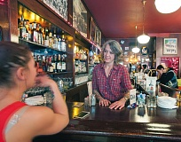 Photo Credit: TRIBUNE PHOTO: JOHN M. VINCENT - Virginia Cafe general manager Leah Douvris arrived at the cafe in 1995 to manage the bar for one month.  Shes still there.