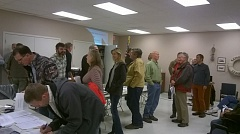 Photo Credit: MARK MILLER - Landowners stand in line to sign in at the annual meeting of members in the Sauvie Island Drainage Improvement Co. on Thursday, Nov. 6.
