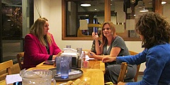 Photo Credit: MARK MILLER - Amanda Normine (center), who leads the 'Twilight in St. Helens' group, speaks during a planning meeting at Sunshine Pizza in St. Helens on Wednesday, Nov. 12. Also pictured are Gretchen Williams (left) and Liz Esposito (right).