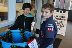 Photo Credit: SPOKESMAN PHOTO: KATE HOOTS - Mason Seal and Gavin Quintanilla, left, are both third-graders and Cub Scouts. Their Scout group honored veterans last week by collecting food and toiletries to send to troops serving overseas. The boys collected items at their school, Boeckman Creek Primary, and will bring additional items to a den meeting where they plan to assemble a total of 80 packages to ship off.