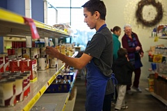 Photo Credit: TIMES PHOTO: JAIME VALDEZ - Evan Marx, a sophomore at Tualatin High School and a board member at Tualatin School House Pantry, faces the soup aisle at the pantry, located in the basement of Rolling Hills Community Church.