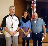Photo Credit: COURTESY PHOTO - Forest Grove High School Dean of Students Dwight Jensen, student of the month Rubi Vergara-Grindell and David Beasley (chair of the Rotary Clubs Youth Funding Committee) pause for a photograph.