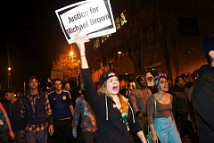 Photo Credit: TRIBUNE PHOTO JAIME VALDEZ - Ferguson protesters march along Southwest Salmon Street in downtown Portland on Tuesday.
