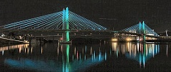 Photo Credit: JONATHAN HOUSE - The new Tilikum Crossing Bridge across the Willamette River lit up October 16 and 17 when TriMet tested its ambient lighting system. This picture was taken by Portland Tribune photographer Jonathan House at around 8:45 pm on the 16th.