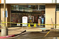 Photo Credit: DAVID F. ASHTON - With the debris cleared away, workers begin rebuilding the entrance to the Creston-Kenilworth Walgreen store, after thieves smashed their way in with an SUV, to steal the Automatic Teller Machine.