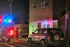 Photo Credit: DAVID F. ASHTON - Firefighters investigate the location of this fire in an apartment building on S.E. Woodstock Boulevard.