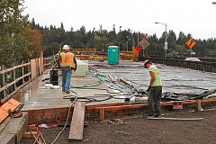 Photo Credit: DAVID F. ASHTON - Workers finish the new Sellwood Bridge east side approach - it was opened to carry traffic, starting in late November.
