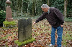 Photo Credit: ESTACADA NEWS PHOTO: ISABEL GAUTSCHI - Tiny Gibson Cemetery in Eagle Creek holds a lot of history. Gary Ames, who sits on the Estacada Cemetery District Board of Directors, points to a 1799 birthdate on a headstone.