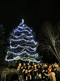 Photo Credit: HILLSBORO TRIBUNE PHOTO: DOUG BURKHARDT - Members of the Neil Armstrong Middle School choir sing Christmas carols during the tree lighting ceremony Friday evening at Veterans Memorial Park in Cornelius. Dozens of residents turned out for the festive event, which included a visit from Mr. and Mrs. Santa Claus, who arrived in a Cornelius Fire Department fire truck.
