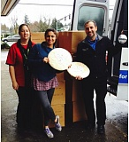 Photo Credit: CONTRIBUTED PHOTO - Ravinder Waraich, center, store manager for the 7-Eleven store on Northeast Kane Drive in Gresham, and  assistant manager Michelle Jensen, left, recently donated 232 pizzas to a representative of Birch Community Services. The pizzas were purchased as a pay it forward campaign by customers.