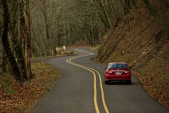 Photo Credit: OUTLOOK PHOTO: TROY WAYRYNEN -  motorist drives along a curvy and narrow stretch of the Columbia River Highway east of Troutdale on Dec. 15. To support tourism, the Friends of Historic Columbia River Highway are asking support from the city of Troutdale to improve the road and make it more bicycle friendly.