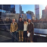 Photo Credit: COURTESY PHOTO - Sean (left) and Margaret (second from right) Connors, both Forest Grove High graduates, took University of Oregon quarterback and Heisman Trophy winner Marcus Mariota (center) on a tour of the 9/11 memorial in New York City Monday along with their dad, Jim Connors (far right).