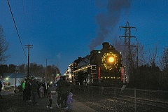 Photo Credit: DAVID F. ASHTON - As the sun sets, the SP&S 700 locomotive idles while passengers disembark.