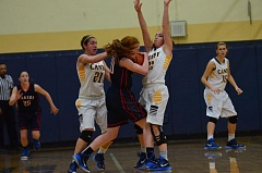 Photo Credit: HERALD PHOTO: COREY BUCHANAN - Skylee Doman (left) and Cianne Cates trap a Lake Oswego player.