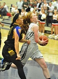 Photo Credit: MATTHEW SHERMAN - Lake Oswego's Gillian Mair finishes off a fast break after coming up with a defensive steal during the Lakers' league-opening game at home against West Linn last week.