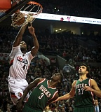 Photo Credit: COURTESY OF MICHAEL WORKMAN - Starting power forward Thomas Robinson slams for two points in the Trail Blazers' Wednesday night victory against the Milwaukee Bucks, as Johnny O'Bryant III and Zaza Pachulia (right) watch in vain.