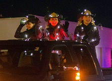 Photo Credit: SUBMITTED PHOTO - Pictured at the 2014 Canby Light the Night Parade are, from left, Princess Alyson Fazzolari, Queen Jessi Cornforth and Princess Emmaly  Widmer.