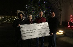 Photo Credit: PHOTO COURTESY: JESSICA GAGO - Clackamas Volunteers in Medicine, the charity winner of $500, accepting their prize with with David Nash (far right), board president for the Downtown Oregon City Association.
