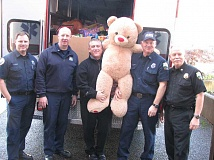 Photo Credit: SUBMITTED PHOTO: KAREN CARNAHAN - Helping deliver toys on Friday (from left): Firefighter Brian Wheeler, Deputy Fire Marshal David Smith, Battalion Chief Jim Doane, Lt. Paul Lorenzen and Assistant Chief Larry Goff.