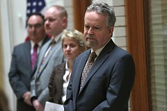 Photo Credit: TRIBUNE PHOTO: JONATHAN HOUSE - Dr. Dennis Rosenbaum and his team will evaluate city progress implementing the U.S. Department of Justice settlement agreement. Behind him, from left, are former Oregon Supreme Court Chief Justice Paul De Muniz, Tom Christoff, and Dr. Amy Watson.