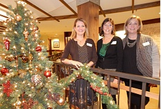 Photo Credit: REVIEW PHOTO: CLIFF NEWELL - The staff of The Springs at Carman Oaks seeks to make Christmas a time to celebrate, even for those enduring grief and loss. From left: Erin Christ, Lisa Oetken and Amy Brown.