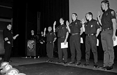 Photo Credit: CONTRIBUTED PHOTO - Sandy Fires 2014 recruit class is sworn in by Deputy Fire Chief Phil Schneider.