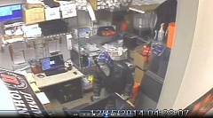 Photo Credit: PHOTO COURTESY: OCPD - Video surveillance inside the Jimmy Johns shows the suspect attempting to break into the sandwich shop's safe.