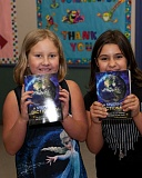 Photo Credit: PHOTO BY: JAL DUNCAN - John Wetten third graders Samantha Ploub (left) and Makenzie Wells show off their new dictionaries, a gift to all Gladstone third graders from the Gladstone/Oak Grove Rotary Club.
