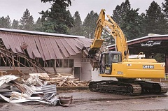 The livestock barn at the Clackamas County Event Center gets torn down.