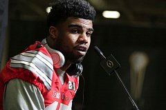 Photo Credit: TRIBUNE PHOTO: JONATHAN HOUSE - Ohio State running back Ezekiel Elliott answers questions at Saturday's media day in Dallas.