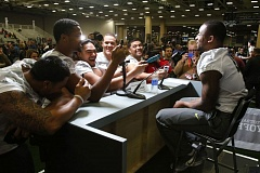 Photo Credit: TRIBUNE PHOTO: JONATHAN HOUSE - Some of the Oregon Ducks clown around on media day, doing a mock interview of cornerback Erick Dargan.