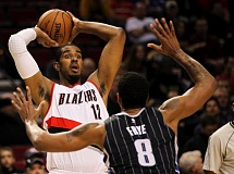Photo Credit: COURTESY OF DAVID BLAIR - Blazers forward LaMarcus Aldridge looks to pass against former Blazer forward Channing Frye during Saturday night's NBA game at Moda Center. Aldridge's 25 points led Portland in a 103-92 victory over the Orlando Magic.