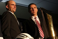 Coaches Mark Helfrich of Oregon (left) and Urban Meyer of Ohio State, wearing school-appropriate ties, pose with the trophy that will go to one of them after Monday night's College Football Playoff final at Arlington, Texas.