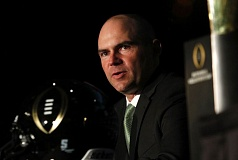 Photo Credit: TRIBUNE PHOTO: JONATHAN HOUSE - Oregon Ducks coach Mark Helfrich responds to a question Sunday during a press conference leading up to the national championship game against Urban Meyer's Ohio State Buckeyes.