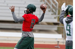 Photo Credit: TRIBUNE PHOTO: JONATHAN HOUSE - Oregon Ducks quarterback Marcus Mariota winds up for a pass during practice in Dallas for the national championship game.