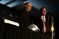 Photo Credit: TRIBUNE PHOTO: JONATHAN HOUSE - The national championship game coaches - Mark Helfrich (left) of Oregon and Urban Meyer of Ohio State - go through a photo opportunity Sunday morning in Dallas.