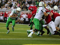 Photo Credit: TRIBUNE FILE PHOTO: JAIME VALDEZ - Taylor Alie (left) runs toward the end zone on a two-point conversion play for the Oregon Ducks in their 2014 season opener against South Dakota.