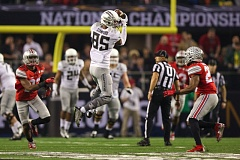 Photo Credit: TRIBUNE PHOTO: JAIME VALDEZ - Dwayne Stanford of Oregon makes a first-half catch over the middle against Ohio State.