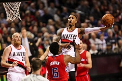 Photo Credit: COURTESY OF DAVID BLAIR - Damian Lillard has his path to the basket by DeAndre Jordan on Wednesday night, as the Los Angeles Clippers beat the Trail Blazers 100-94 at Moda Center.